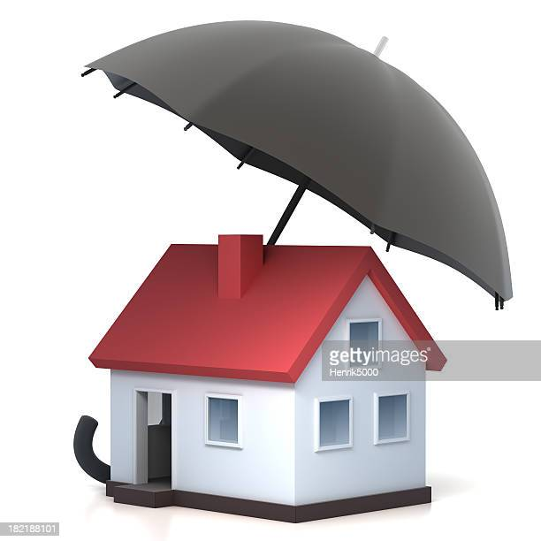 Home under umbrella - with clipping path