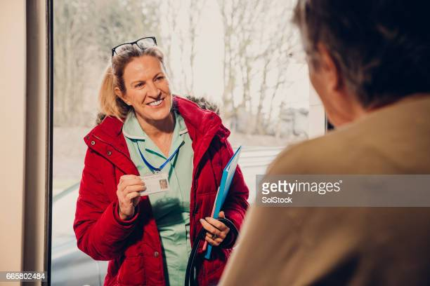 home visit for one senior woman - social services stock photos and pictures