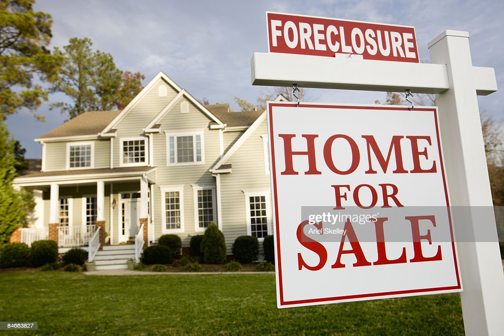 Home with foreclosure sign in front yard : Stock Photo