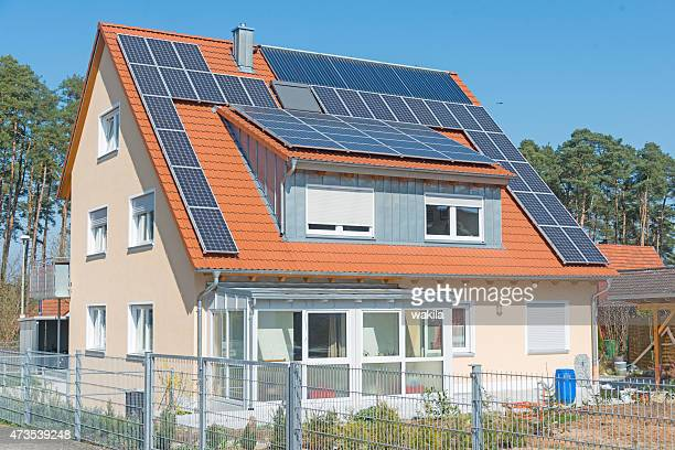 home with solar panels on roof - real_property stock pictures, royalty-free photos & images