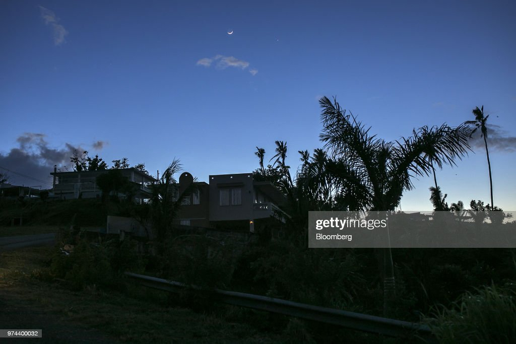 A home without electricity since Hurricane Maria stands in the town of Jacanas, Yabucoa, Puerto Rico, on Friday, May 18, 2018. The bankrupt U.S. commonwealth's investment bankers last week started sounding out suitors for the eight-decade-old monopoly known asPrepa, whose rickety infrastructure was almost erased by Hurricane Maria in 2017. The halting efforts to repair the damage and improve the antiquated grid have been the central obstacle in recovery. Photographer: Xavier Garcia/Bloomberg via Getty Images