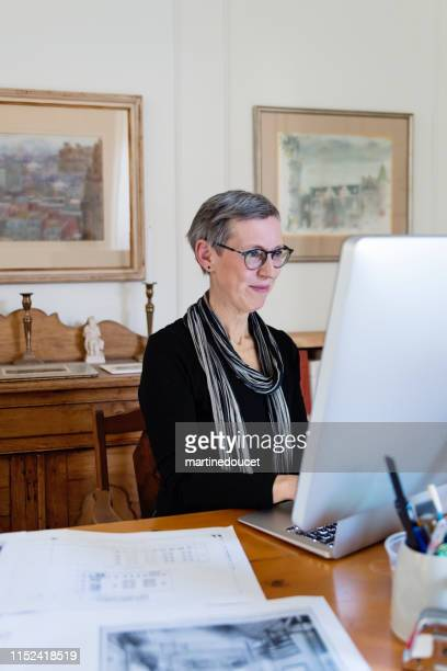 "60+ home working professional architect and historian woman - ""martine doucet"" or martinedoucet bildbanksfoton och bilder"