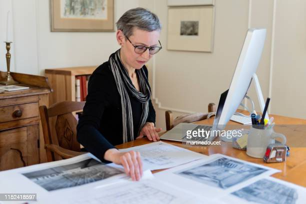 "60+ home working professional architect and historian woman - ""martine doucet"" or martinedoucet bildbanksfoton och bilder"