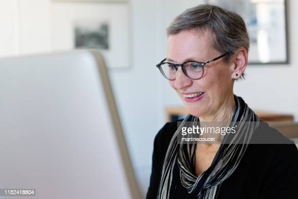 60+ home working professional architect and historian woman