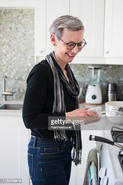 """60+ home working professional woman having lunch - """"martine doucet"""" or martinedoucet stock pictures, royalty-free photos & images"""