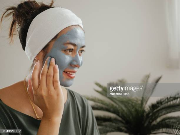home wpa woman  women applying a facial mask - wpa stock pictures, royalty-free photos & images