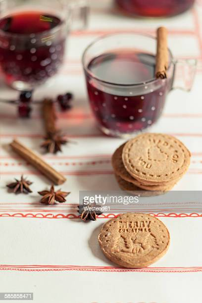 Home-baked almond biscuits, glasses of mulled wine and spices