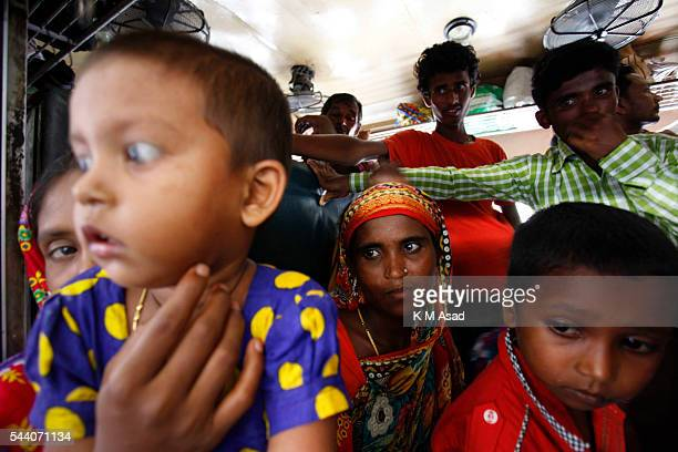 Homebound people travel on an overloaded train as they travel to their villages before the Eid AlFitr the Muslim biggest festival celebrations in...