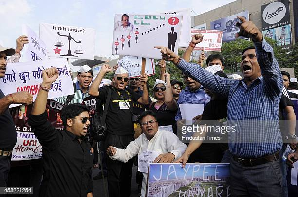 Home-buyers of National Capital Region staged a protest against builders and developers who failed to deliver group housing projects in stipulated...