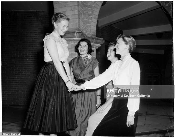Homecoming, December 24 1953. Mary Frances Boyd;Marianne Frey;Nancy Baldwin;Florine Petrulis. .;Caption slip reads: 'Photographer: McCarty. Date: ....