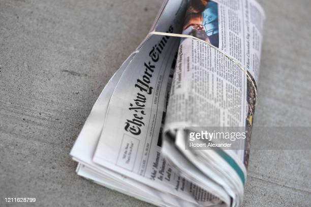 A homedelivered copy of The New York Times in a driveway in Santa Fe New Mexico