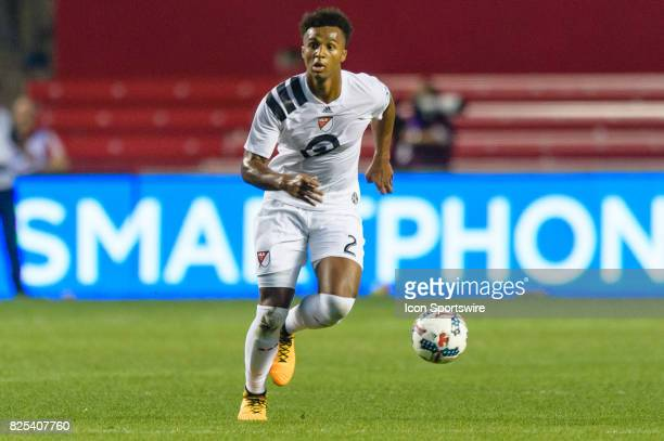 Homegrown and Sporting Kansas City defender Erik PalmerBrown dribbles the ball in the second half during a soccer match between the MLS Homegrown...