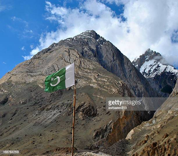 homeland of mountains - pakistani flag stock photos and pictures