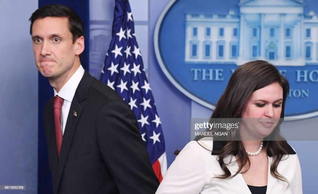 Homeland Security Advisor Tom Bossert (L) walks past White House Principal Deputy Press Secretary Sarah Huckabee Sanders as she arrives for the daily briefing in the Brady Briefing Room of the White House on May 11, 2017 in Washington, DC. /