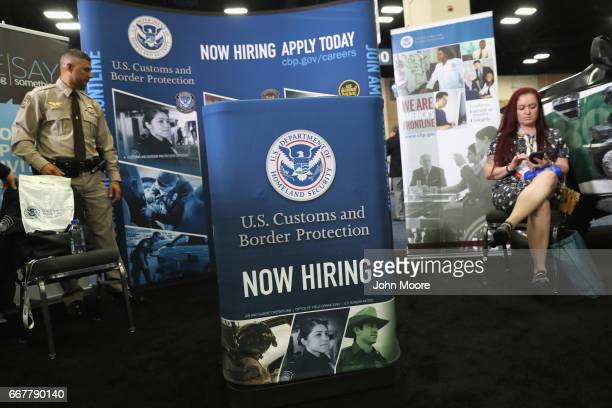 Homeland Security agent mans an exhibit at the Border Security Expo on April 12 2017 at the Henry B Gonzalez Convention Center in San Antonio Texas...