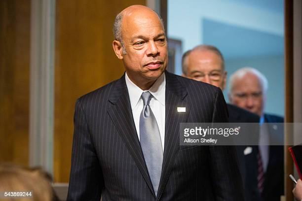Homeland Security Chief Jeh Johnson followed by Senate Judiciary Committee Chairman Chuck Grassley and Ranking Member Senator Patrick Leahy enters...