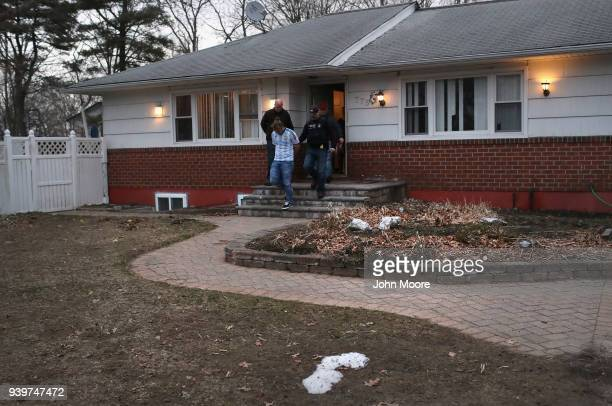 Homeland Security Investigations ICE agents detain a suspected MS13 gang member and Honduran immigrant at his home on March 29 2018 in Brentwood New...
