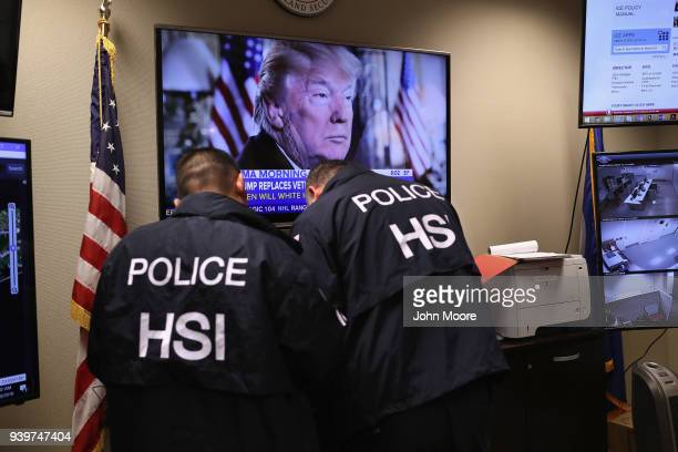 Homeland Security Investigations ICE agents work in a control center as field agents arrest suspected immigrant gang members in Central Islip New...