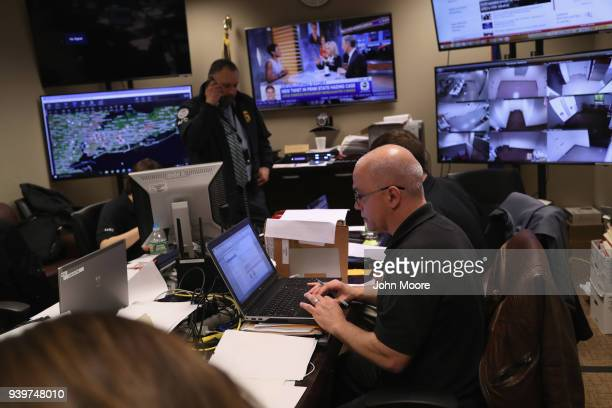 Homeland Security Investigations ICE agents work in a control center during an operation targeting suspected immigrant gang members in Central Islip...