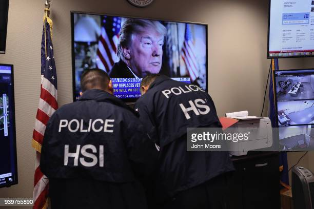 Homeland Security Investigations ICE agents work in a control center during an operation targeting immigrant gangs in Central Islip New York...