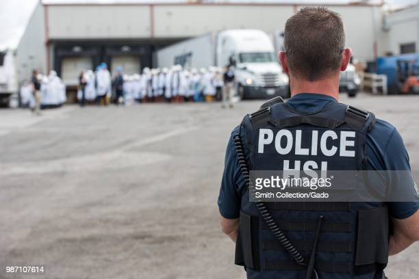 Homeland Security Investigations special agent preparing to arrest alleged immigration violators at Fresh Mark Salem June 19 2018 Image courtesy ICE...