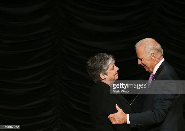 Homeland Security Janet Napolitano is congratulated by US Vice President Joe Biden after delivering her farewell speech at the Ronald Reagan Building...