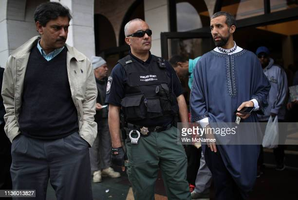 Homeland Security officer keeps watch following Friday prayers at the Dar Al Hijrah Islamic Center March 15 2019 in Falls Church Virginia 49 people...