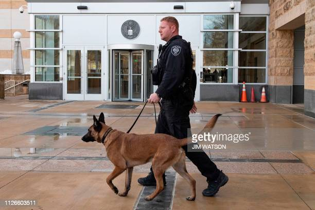 A Homeland Security Police Officer patrols outside the US Court House in Greenbelt MD on February 21 as US Coast Guard Lt Christopher Hasson of...