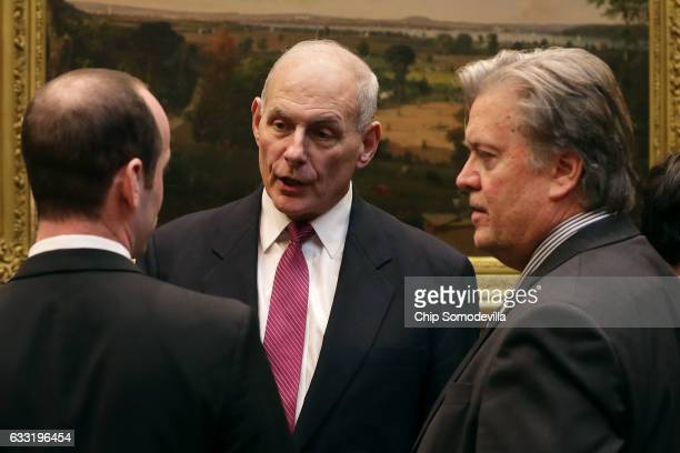 Homeland Security Secretary John Kelly talks with White House Chief Strategist Steve Bannon and Senior Advisor for Policy Stephen Miller before a...