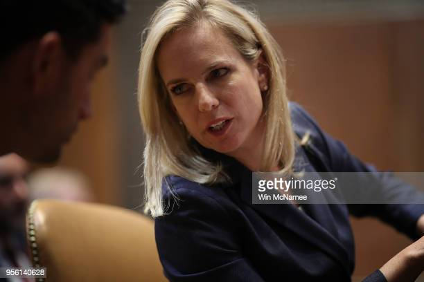 Homeland Security Secretary Kirstjen Nielsen confers with an aide while testifying before the Senate Appropriations Committee May 8 2018 in...