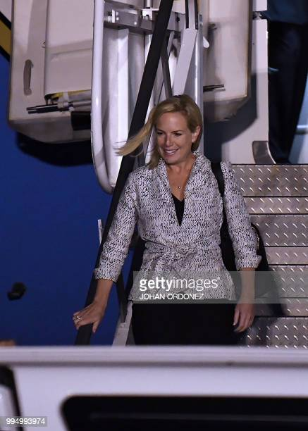 US Homeland Security Secretary Kirstjen Nielsen descends from the plane upon landing at the Air Force Base in Guatemala City on July 9 2018 Nielsen...