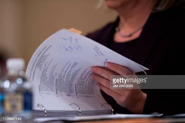 Homeland Security Secretary Kirstjen Nielsen flips through her notes on the border and immigration as she testifies before the House Homeland...