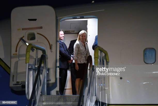 US Homeland Security Secretary Kirstjen Nielsen smiles before descending from the plane upon landing at the Air Force Base in Guatemala City on July...