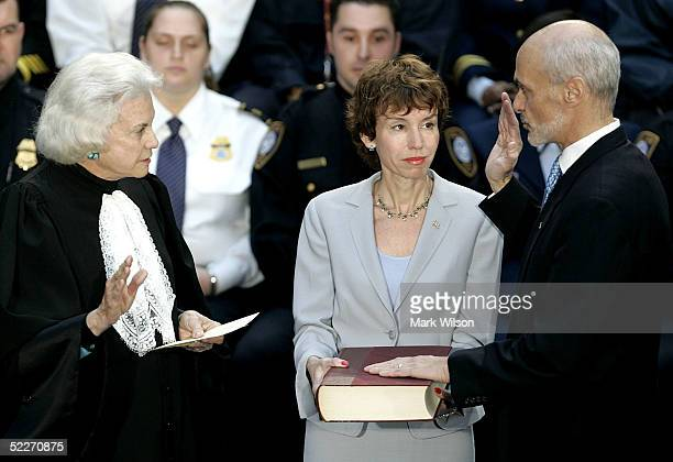 Homeland Security Secretary Michael Chertoff is sworn in by US Supreme Court Justice Sandra Day O'Connor as his wife Meryl Chertoff holds a bible...