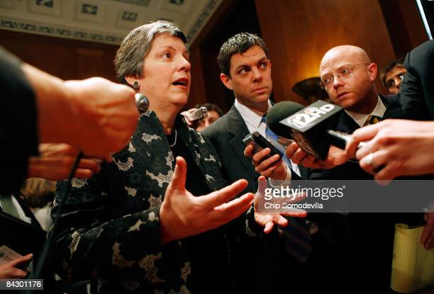 Homeland Security Secretary-designate and Arizona Governor Janet Napolitano talks with reporters at her confirmation hearing before the Senate...