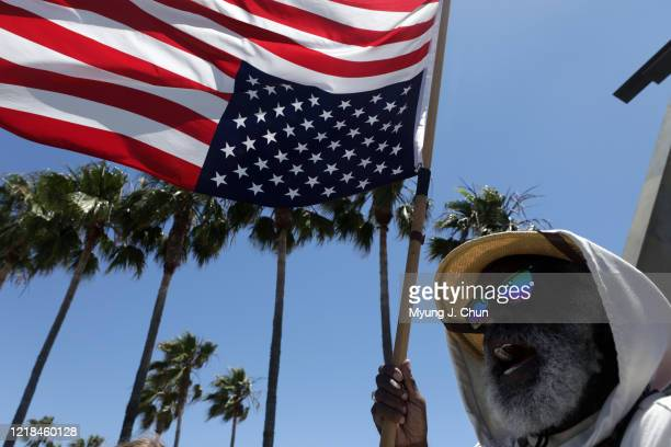 Homeless activist Ted Hayes sitting at Venice Beach CA says he will fly the flag upside down until the social injustices of homelessness Black Lives...