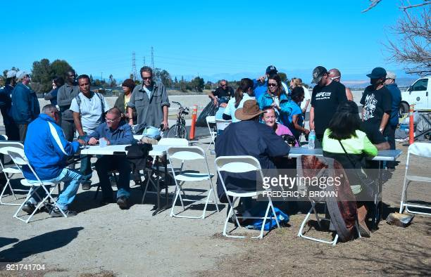 Homeless and transients meet with county officials ater waiting in line at the homeless encampment beside the Santa Ana River in Anaheim California...