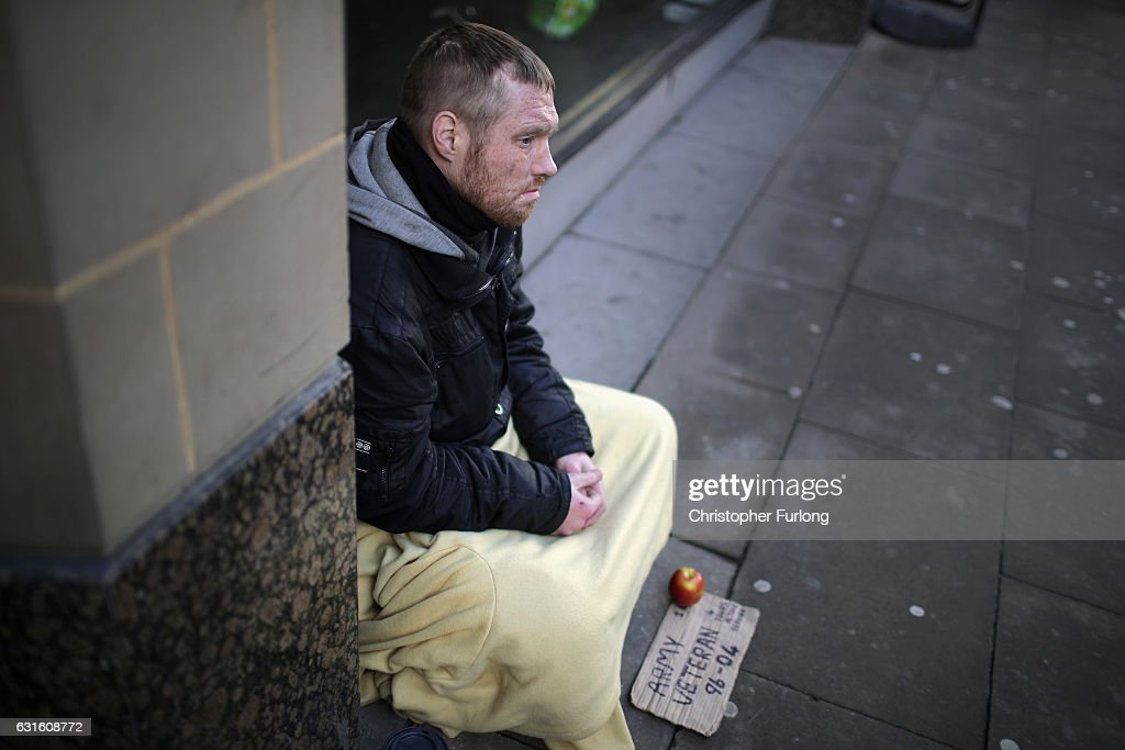 Homeless army veteran Phil (no surname given) begs for small change on the streets of Manchester on January 13, 2017 in Manchester, United Kingdom. Many homeless people are spending the night on the streets in freezing temperatures as the Met Office continues to issue weather warnings across the country. Despite work by charities to help the homeless. Official figures record that there were 1,850 people sleeping rough in the whole of England in 1998, in a 2015 survey the figure has jumped to 8,096 sleeping on the streets in London alone