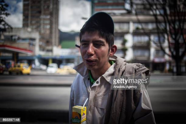 A homeless boy drinks his juice distributed by volunteers in Bogota Colombia on December 15 2017 Homeless people who are called 'CHC' Ciudadanos...