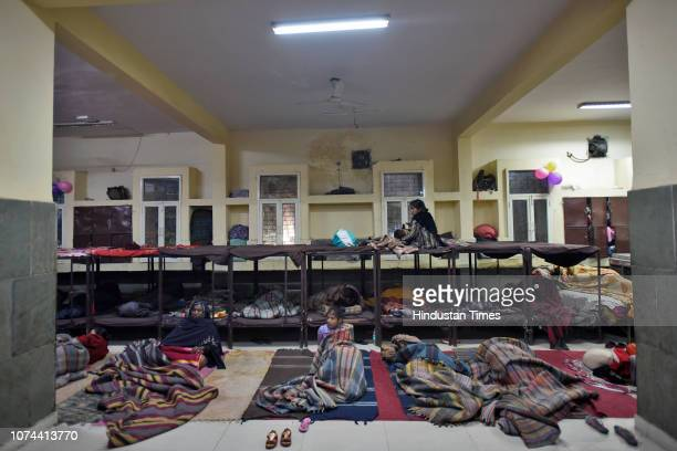A homeless boy sleeps inside a shelter home at Nizamuddin Basti on December 18 2018 in New Delhi India There are some 83 permanent shelters and 115...