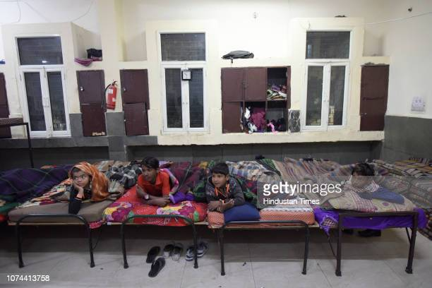 Homeless boys lying on their beds inside a shelter home at Nizamuddin Basti on December 18 2018 in New Delhi India There are some 83 permanent...