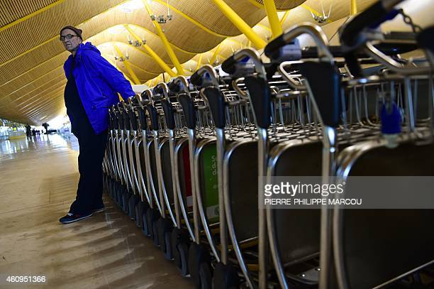 PARRY Homeless Bulgarian Valentin Giorgiev poses in front of lugage trolleys at Adolfo SuarezBarajas airport's terminal 4 in Madrid on December 30...