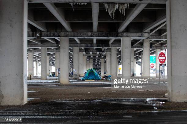 Homeless camp under a bridge on I-35 in Austin, Texas on February 17, 2021. Millions of Texans are still without water and electric as winter storms...