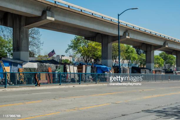 homeless camp under the bart in oakland - oakland california stock pictures, royalty-free photos & images