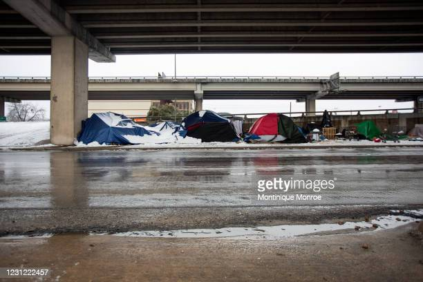 Homeless camps sit along the I-35 frontage road in Austin, Texas on February 17, 2021. Millions of Texans are still without water and electric as...