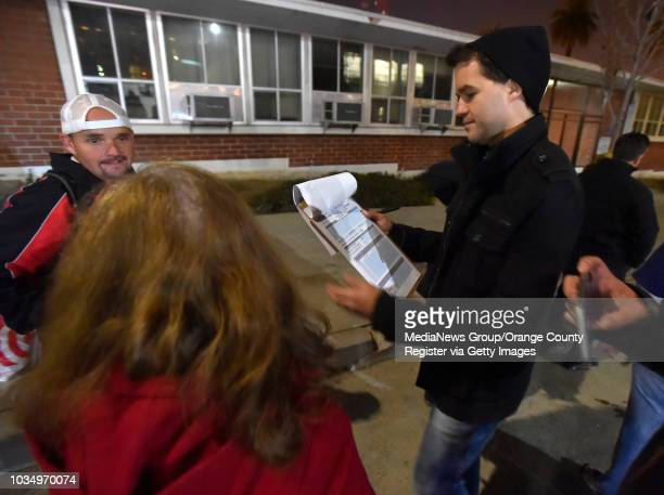 Homeless census taker Chris Jenne right tallies up the number of homess men and women they encounter near the downtown post office in San Pedro CA on...