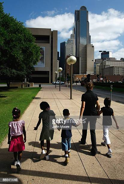 Homeless children are led to a soup kitchen for lunch on June 17, 2009 in Dallas, Texas. The National Center on Family Homelessness reported this...