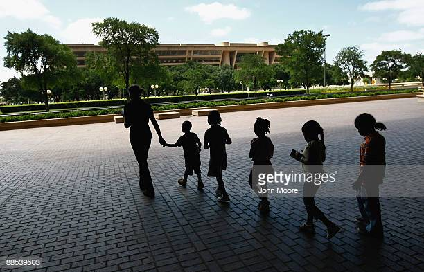 Homeless children are led to lunch at a soup kitchen on June 17, 2009 in Dallas, Texas. The National Center on Family Homelessness reported this year...