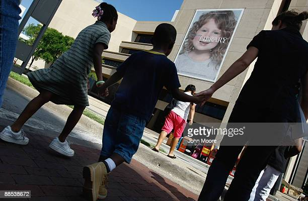 Homeless children arrive to the Dallas Public Library with a mentor from the Family Gateway homeless shelter on June 17, 2009 in Dallas, Texas. The...