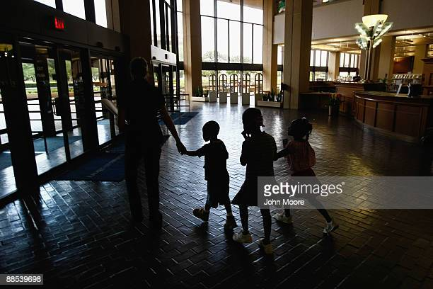 Homeless children leave the Dallas Public Library while walking to eat lunch at a soup kitchen on June 17, 2009 in Dallas, Texas. The National Center...